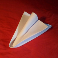 How to fold napkins - A finished versions on the Arrowhead napkin fold.