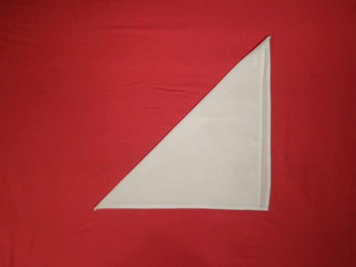 French Fold Folding Napkins Step Two fold the top left corner down to the bottom right