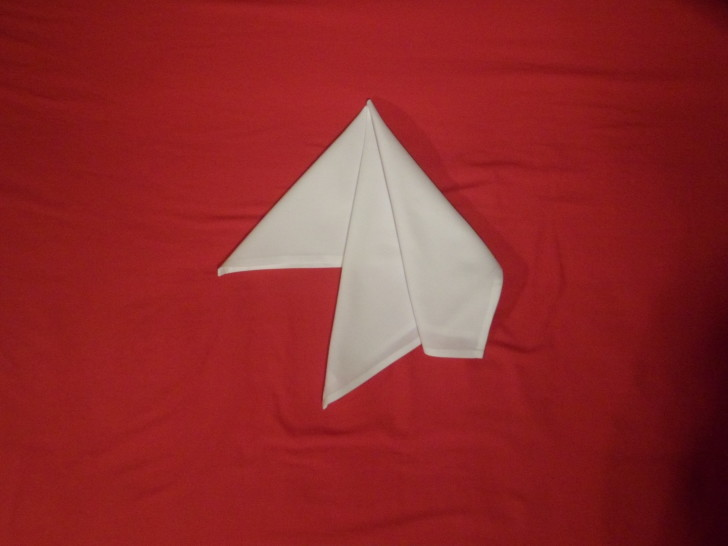 French Fold Folding Napkins Step Four Repeating a very similar fold as the previous step take the top corner and fold it down on its self.