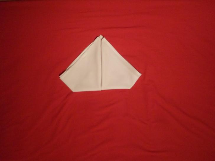 Fancy Napkin Folding Techniques   Rosebud Fold Step Seven flip the napkin back over