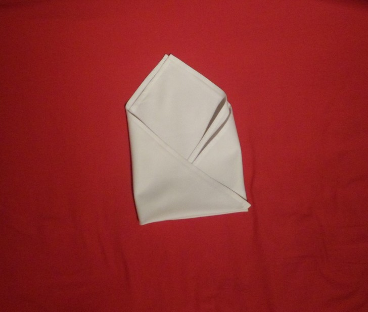 Folding Napkins for Silverware - The Silverware Roll Step Six Fold the left hand side over so the napkin looks like an envelope