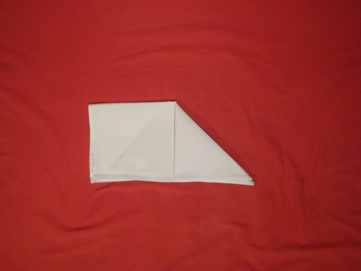 Napkin Folding Instructions The Sail Fold Step three fold the top right corner down to the bottom edge