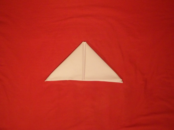 Napkin Folding Instructions The Sail Fold Step  Four fold the left corner over making a triangle