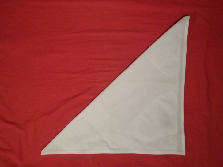 How To Fold Napkins The Crown Fold Step Two fold the napkin diagonally