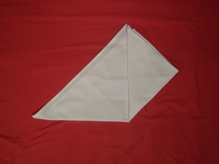 How To Fold Napkins The Crown Fold Step Three Fold the bottom right corner up to the centre. Try your best to get it all symmetrical