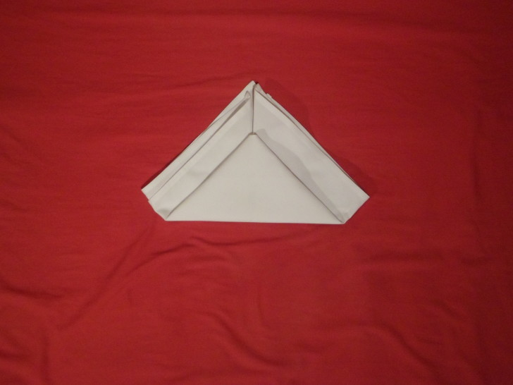 How To Fold Napkins The Crown Fold Step Five Fold the bottom up leaving about an inch from the top
