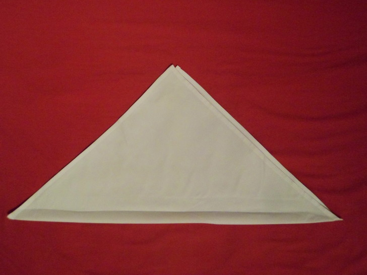 Free Napkin Folding Instructions Candle Fold Step Two fold the napkin in half diagonally