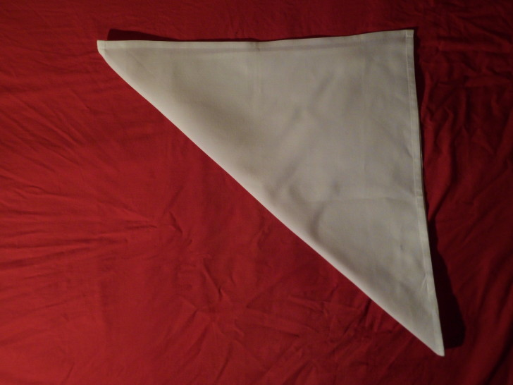 Folded Napkin Pyramid Fold Step Two Fold the napkin in half diagonally