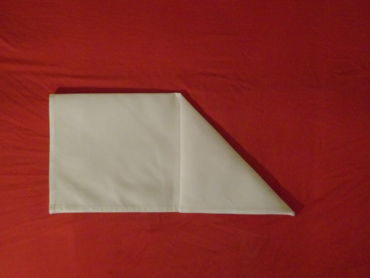 How to fold napkins arrowhead. Step three fold the top right corner down to the centre on the open bottom edge of the napkin.