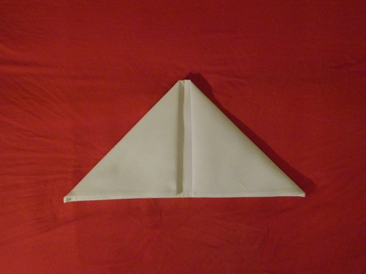 How to fold napkins arrowhead. Step four repeat the same movement as the previous step but with the top left corner. The napkin should now look like a triangle.