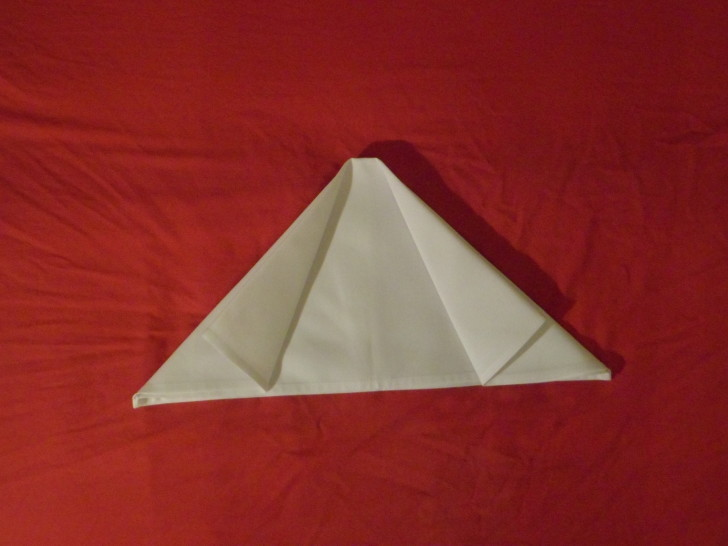 How to fold napkins arrowhead. Step six repeat the previous step with the opposite side of the napkin folding the left side back out on its self.