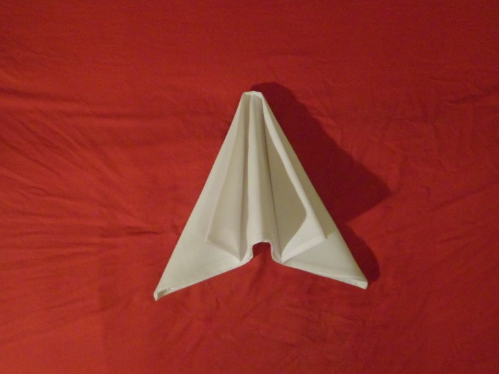 how to fold napkins Arrowhead eight place your hands flat on the top of the napkin fold and push the two outsides together causing the middle to rise up.
