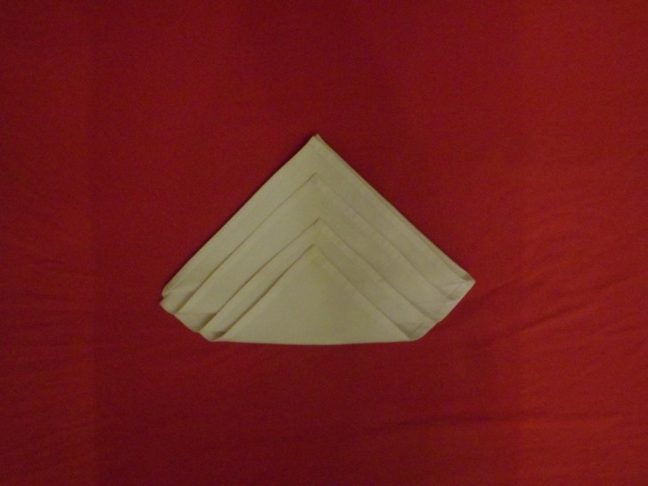 Napkin Origami The Diamond Fold Step Seven Fold the final layer up creating a sort of flat bottomed diamond shape