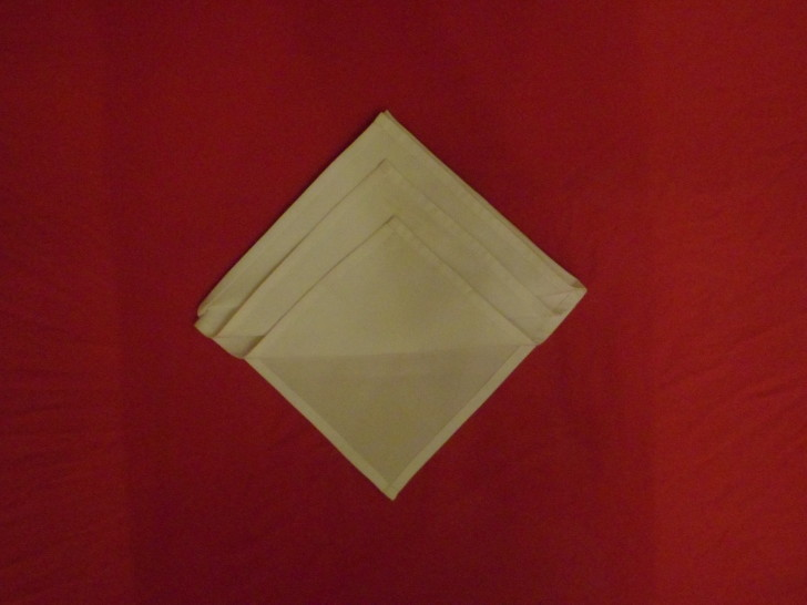 Napkin Origami The Diamond Fold Step Six Repeat the same as the previous steps only leaving it slight lower once more