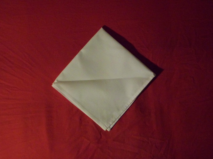 Napkin Origami The Diamond Fold Step Three Fold the napkin in half again making it look like a diamond