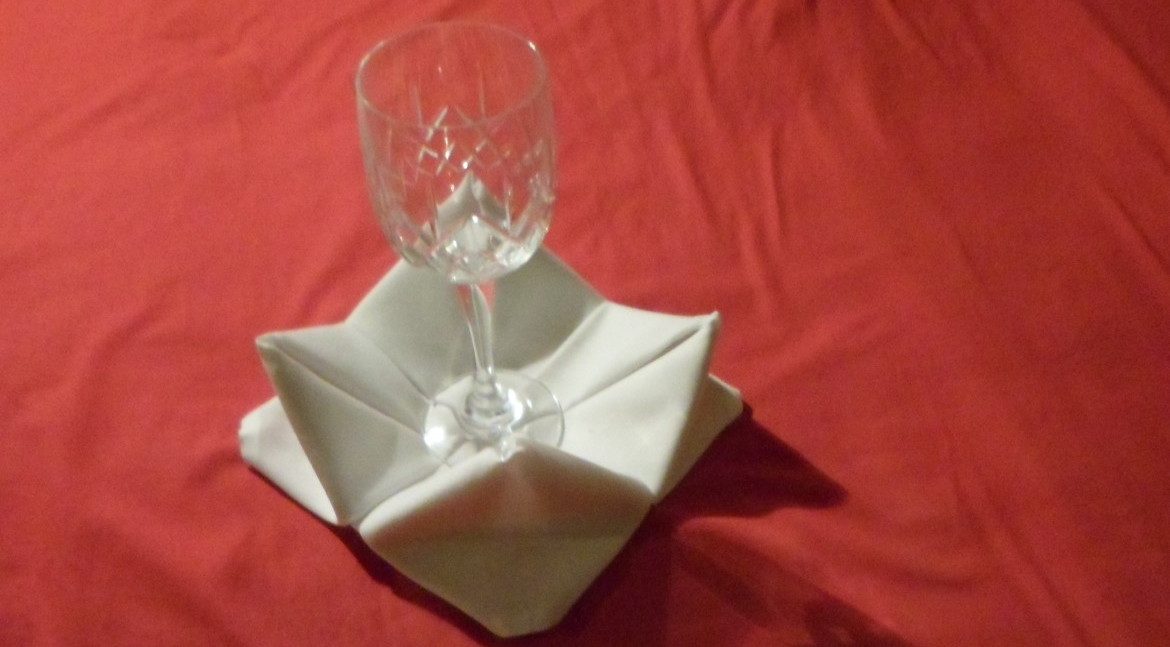 A brilliant way to recover a table display if you cant find coasters. The rose napkin fold looks exactly how it sounds and is a rather challenging fold to complete