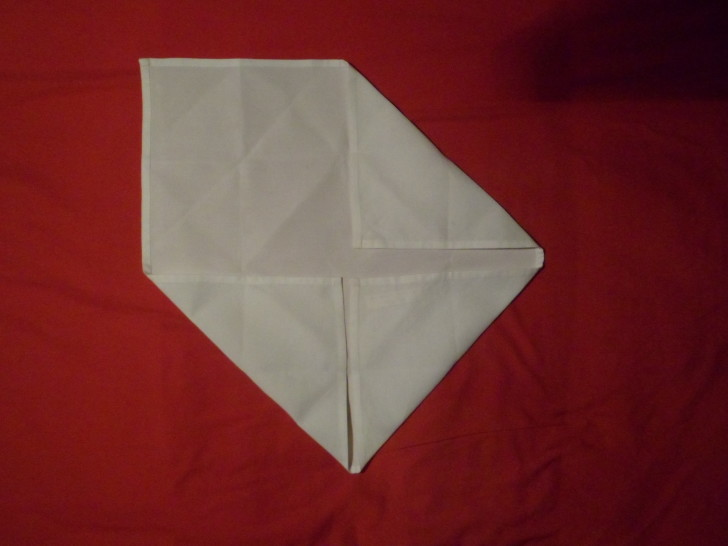 Napkin Folding Rose Fold Step Four fold the top right down so the napkin resembles an envelope