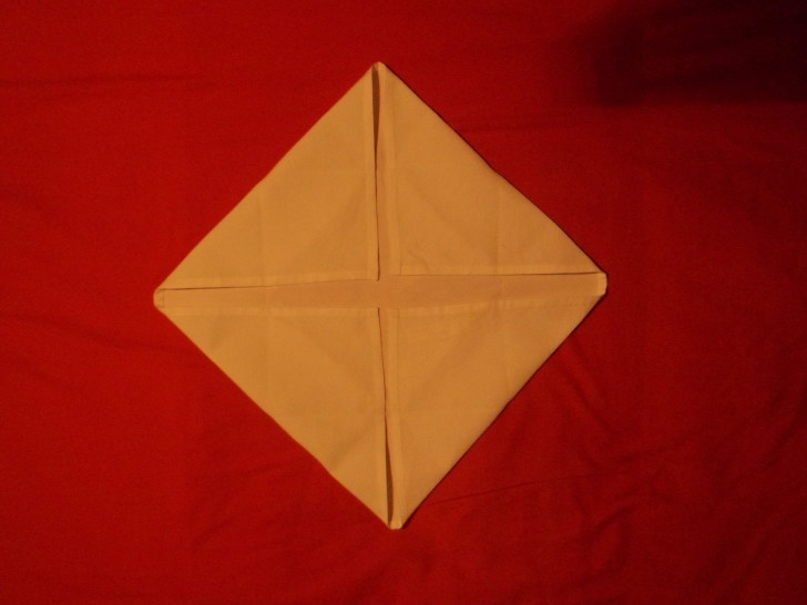 Napkin Folding Rose Fold Step Five fold the top left down closing the envelope