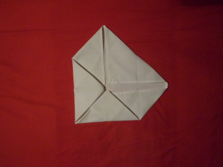Napkin Folding Rose Fold Step Seven fold the left corner in to the centre