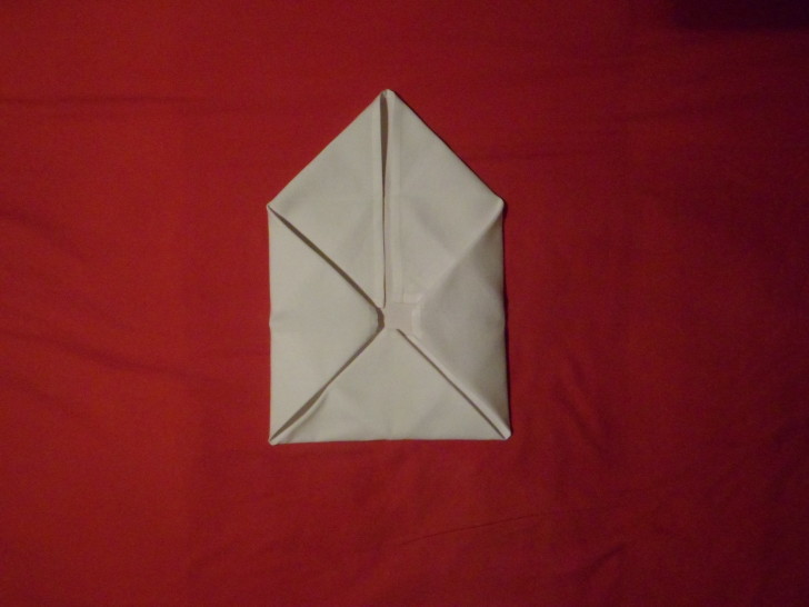 Napkin Folding Rose Fold Step Eight Fold the right corner in so you have a envolope once more.