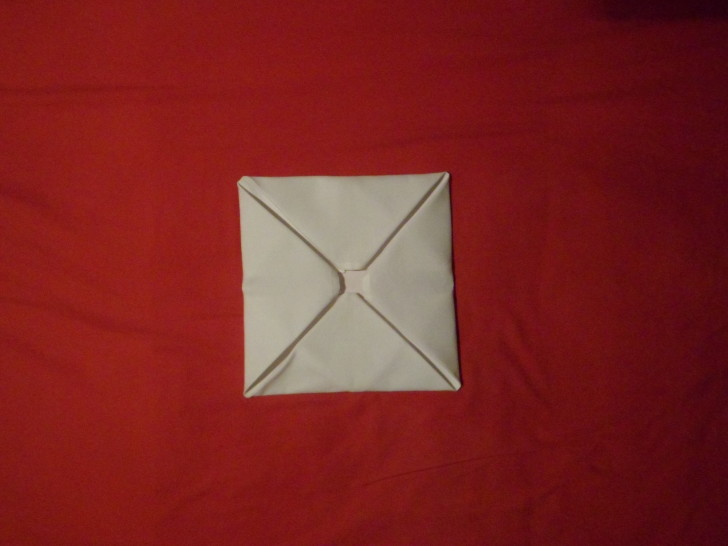Napkin Folding Rose Fold Step Nine fold the last corner down from the top as if you were shutting an envelope